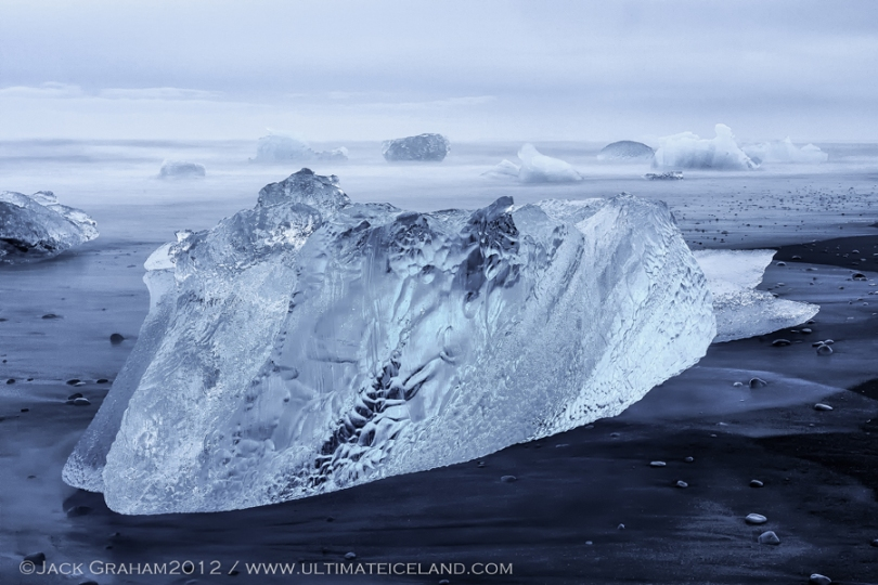 ice on black beach by jack graham