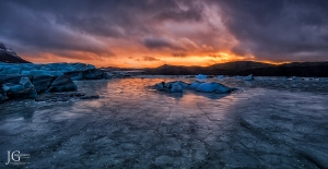 sunset over icy lagoon