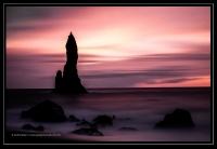monolith on beach
